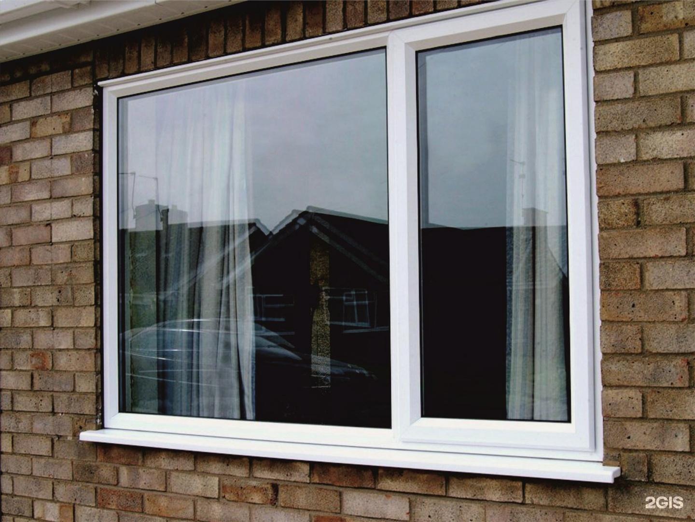 Пластиковые окна на балкон сдвигающиеся в одно.